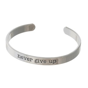 "Silver tone cuff bracelet stamped with ""never give up."""