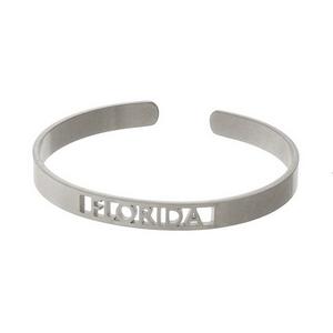 Silver tone cuff bracelet with a Florida cutout.