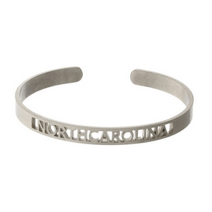Silver tone cuff bracelet with a North Carolina cutout.