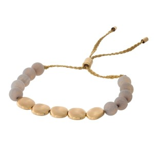 Gray natural stone and gold tone beaded pull-tie bracelet.