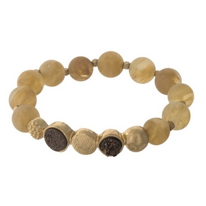 Beige beaded stretch bracelet with faux druzy stones and gold tone accents.