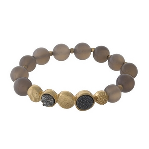 Gray beaded stretch bracelet with faux druzy stones and gold tone accents.