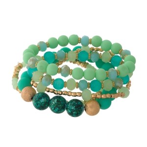 Four piece, mint green and gold tone beaded stretch bracelet set.