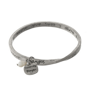 Silver tone bangle bracelet stamped with the Serenity Prayer.