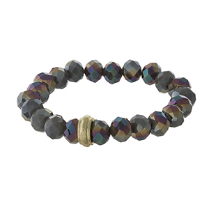 Iridescent gray beaded stretch bracelet with a gold tone accent.