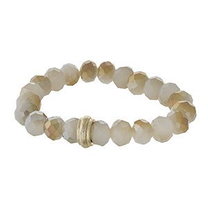 Ivory beaded stretch bracelet with a gold tone accent.