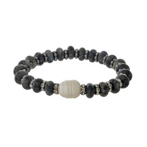 Black semi-precious stone stretch bracelet with a freshwater pearl bead accent.
