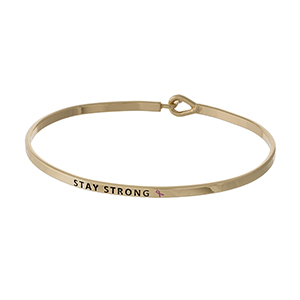 "Dainty gold tone Breast Cancer Awareness bracelet, stamped with ""Stay Strong."""