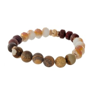 Beige and picture jasper, natural stone beaded stretch bracelet with gold tone accents.