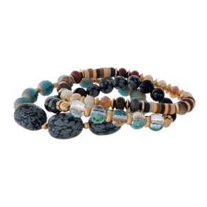 Three piece, gray and black, natural stone beaded stretch bracelet set with gold tone accents.