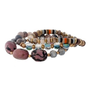 Three piece, gray and mauve, natural stone beaded stretch bracelet set with gold tone accents.