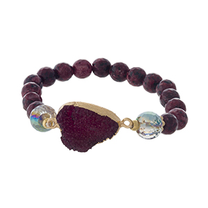 Burgundy natural stone beaded stretch bracelet with a faux druzy stone focal.
