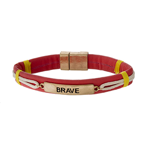 """Faux leather magnetic bracelet with a gold tone bar stamped with """"Brave."""""""