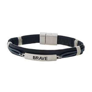 """Faux leather magnetic bracelet with a silver tone bar stamped with """"Brave."""""""