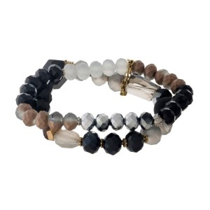 Black and gray beaded, two-row stretch bracelet with a matte finish and gold tone accents.