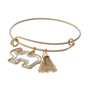 Gold tone, adjustable bangle bracelet with an open, two tone elephant and tassel charm.