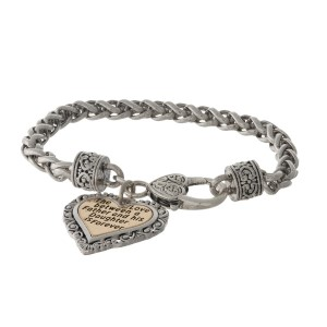 "Silver tone bracelet with a two tone heart charm stamped with ""The love between a Father and his Daughter is forever."""