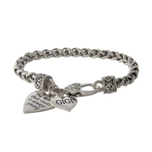 """Silver tone bracelet with two heart charms stamped with """"The heart that loves is always young"""" and """"Gigi."""""""