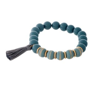 Gray beaded stretch bracelet with wooden beads and a tassel accent.