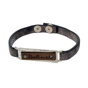 """Faux leather snap bracelet with a bar and wooden focal stamped with """"Believe."""""""