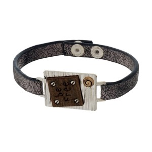 """Faux leather snap bracelet with a bar and wooden focal stamped with """"Be Free."""""""