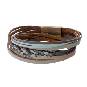 Genuine leather wrap bracelet with a gold tone magnetic closure and animal print.