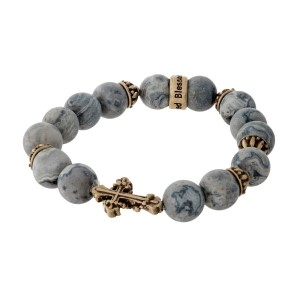 Gray jasper, natural stone, beaded stretch bracelet with a gold tone cross.
