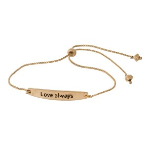 """Metal, pull-tie bracelet with a bar focal stamped with """"Love Always."""""""
