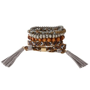 Bracelet set with beaded stretch bracelets and a braided wrap bracelet with tassel accents.