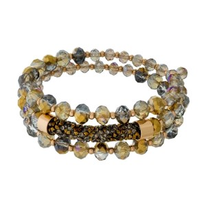 Beaded coil bracelet with a crushed rhinestone bar focal.