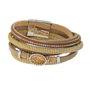 Genuine leather wrap bracelet with a bronze stone, topaz rhinestone accents and a magnetic closure.