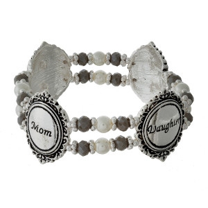 """Pearl beaded stretch bracelet with silver tone shapes, stamped with """"Mom and Daughter."""""""