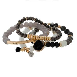 Four piece stretch bracelet set with gold tone accents and a faux druzy stone charm.