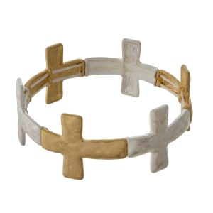 Hammered, silver and gold tone stretch bracelet with cross focals.