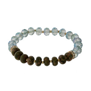Natural stone and faceted bead, stretch bracelet set with gold tone accents.