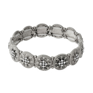 Circle shaped, stretch bracelet with clear rhinestone accents.