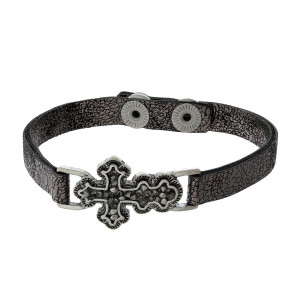 Faux leather snap bracelet with a pave crushed hematite, cross focal.