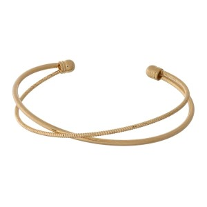 Dainty metal cuff bracelet with a hammered texture.
