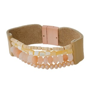 Genuine leather bracelets with natural stones and a gold tone magnetic closure.