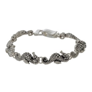 Silver tone magnetic bracelet with sea life focals.