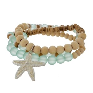Wooden and opal beaded, stretch wrap bracelet with a silver tone starfish charm.