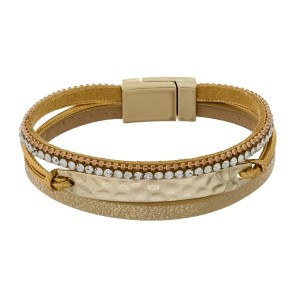 Faux leather bracelet with clear rhinestones, a metallic finish, and a magnetic closure.