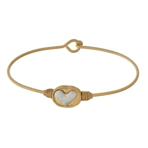 Dainty, metal, bangle bracelet with a wire-wrapped, two tone heart focal.