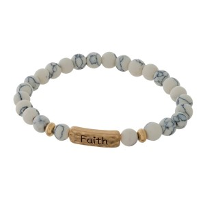 """Natural stone beaded stretch bracelet with a gold tone focal stamped with """"Faith."""""""