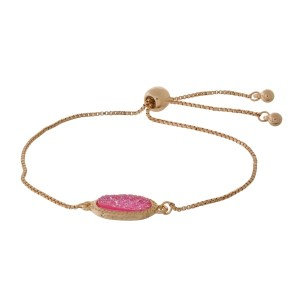 Dainty gold tone bracelet with a faux druzy stone focal and a pull-tie closure.
