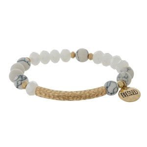 """Natural stone and faceted bead stretch bracelet with a circle charm, stamped with """"Blessed."""""""