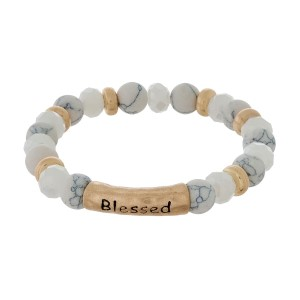 "Natural stone stretch bracelet with a bar focal, stamped with ""Blessed"" and gold tone accents."