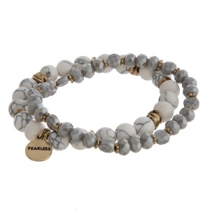 Two row, natural stone and faceted bead stretch bracelet with a gold tone circle charm stamped with an encouraging message.