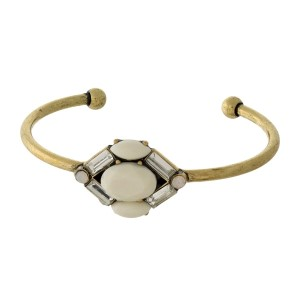 Burnished gold tone cuff bracelet with an epoxy and rhinestone focal.