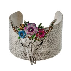 Silver tone cuff bracelet with a hammered texture and a steer head skull.